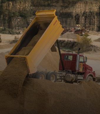 BARD truck dumping aggregate rock